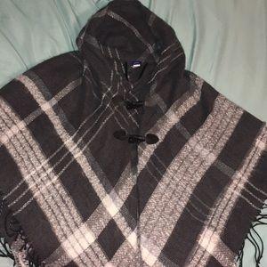 Plaid hooded poncho sweater w/ black fringe